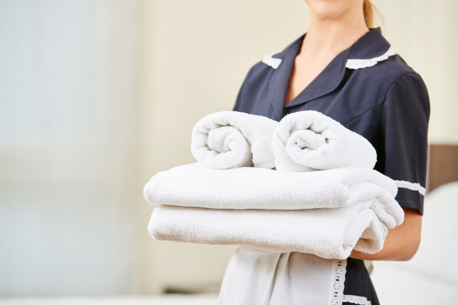 maid with towels